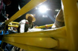 Tyree Kossie, sits in the chutes before competing in the Bull Ridin' competition Monday evening...