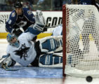 Colorado Avalanche Matthew Barnaby, left, watches in the third period San Jose Sharks goalie...