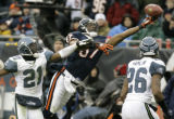 CXA140 - Chicago Bears wide receiver Muhsin Muhammad (87) reaches for a pass while being defended...