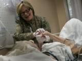 A photo caption on Page News 26 Friday should have said that Nursing Director B.J. Gilmore of...