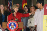 Colorado First Lady Jeannie Ritter talks to  Abwai Eswaran (cq),14, during a press conference...