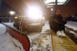 (DLM2413) -  A snow plow clears the RTD train station at the Auraria Campus on Colfax Avenue as...