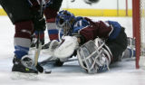 [JPM0358] Colorado Avalanche goalie Peter Budaj pounces on a rebound with help from Avalanche...