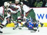[JPM0085] Minnesota Wild center Wes Walz (37) left wing Pascal Dupuis (11) moves in on Colorado...