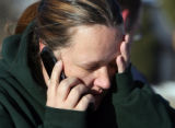 Melody Rose (cq) calls a friend while standing outside  of the Castle West Apartments fire...