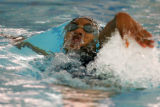 [JPM143] Grandview High School swimmer Brittney Martinez breaks the surface of the water during...