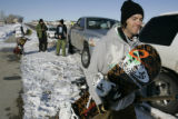 Jeff Cormack (cq) ,27, packs up after being shut down by Longmont officer Sandi Taylor (cq) for...