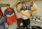 Lance Brittan of Windsor, Colo., puts on his Bull Fighting outfit before making his way to the...
