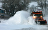 (DLM9322) -  The wind howls as a plow clears snow off of Highway 93 north of Golden, Colo., Wed....