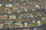 FLPC110 - Severe damage to homes in this retirement community in The Villages, Fla., can be seen...