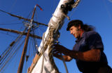 NY428 - ** ADVANCE FOR SUNDAY, AUG. 8 **First mate Al Sorkin prepares to raise the main sail...
