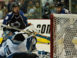 (DENVER, CO - 4/26/04) -- Colorado Avalanche Matthew Barnaby, left, and Alex Tanguay, right, watch...