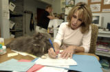 (LAKEWOOD, Colo., May 12, 2004) Ms. Cline works at her desk with routine interference from...
