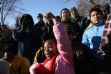 Jala Garnes (cq), 9, center, cheers with others as speakers begin a rally at City Park prior to...