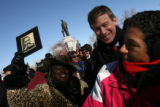 Bridget Johnson (cq), left,  holds a photo of Martin Luther King as Mayor John Hickenlooper,...