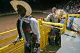 Neal Holmes, left, and Tyree Kossie, right, listen to cheers from the crowd before the Bull Ridin'...