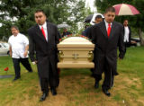 [Denver, CO - Shot on: 7/23/04] Anthony and Frank Lobato Jr.(right) lead the pall bearers as they...