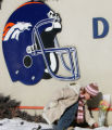 Broncos fan Kim Masciotro (cq), of Aurora, places an angel in memory of Broncos player Darrent...