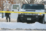 Denver police detectives inspect the scene where Broncos player Darrent Williams was shot in a...
