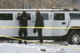 Denver police detectives Tim Kelley(Cq), left, and Bryan Gordon (cq), place evidence markers by...