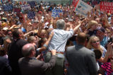 (8/07/2004, La Junta, CO)  John Kerry greets supports with the help of secret service agents who...