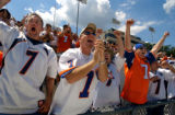(CANTON, Ohio., SHOT 8/8/2004) All dressed in John Elway #7 jerseys and shouting as he is...