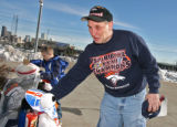 Upset Bronco fan Robert Gleason (cq) looks at a make-shift memorial for Bronco Darrent Williams,...