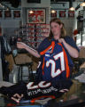 Clerk Steph Taylor (cq) bags up the last two authentic Bronco jerseys ($240 each) of Darrent...