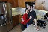Naoko and Phil Jones in their kitchen.  They are doing the backsplash with granite tile...