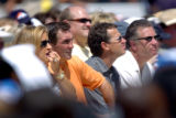 (CANTON, Ohio., SHOT 8/8/2004) Current Broncos' head coach Mike Shanahan (left center, in orange)...
