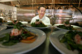 Chef Kevin Taylor prepares plates of lemon grass poached shrimp and melon salad at Palettes...