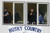 DLM00567   Sheriff Fred Wegener, second from right, calls the game from the press box during the...