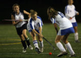 MJM550  Cherry Creek's Catie Tilton, center, tries to pass to teammate, Kate Boren, right, as she...