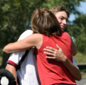 Gunner Wiebe (cq) of Kent Denver gets a hug from his Mother, Cathy Wiebe(cq), after finishing the...