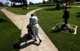(Loveland, Colo., July 25, 2004) Gretchen Bjorkland (cq) pushes her father Richard Vandersluis...