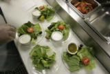Armando Botello, CQ, makes house salads without spinich  at Bambino's at 1135 Bannok  in Denver,...