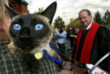 DLM00983   Binky the cat sits on the shoulder of his owner Julian D. Alexander II as they wait to...