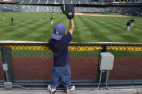 (Denver, Colo., May 11, 2004) Antonio Carmona, 7, of Thornton, waits in the outfield bleachers for...