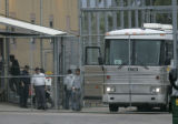 Suspected illegal immigrants are unloaded at the GEO/ICE detention Center in Aurora from an ICE...