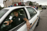 In Agent Michael Thomas' neighborhood Aurora officer Greg Garcia (cq) sat in his patrol car out in...