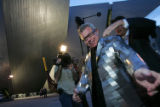 Architect Daniel Libeskind puts on his jacket, a gift from the museum to him, for the party,  as...