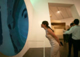 Casey Miller, of New York City, looks at a work by Anish Kapoor at the Hot DAM party to celebrate...