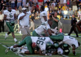 The University of Baylor football teams storms Folsom Field after Baylor linebacker Joe Pawelek...