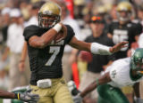 University of Colorado Buffaloes' quarterback Bernard Jackson gets a first down after successfully...