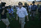 University of Colorado Buffaloes head football coach Dan Hawkins walks off the field after his...