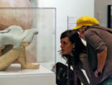 Jennifer Brooks, (cq), left, and Kristin Radakovits (cq) get a close look at a piece called...