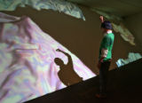 Nik Sifers (cq) gets involved with a piece called Rock Formation Digital Video Projection, by...