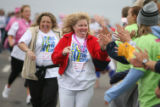 DLM01895   Donna Nelligan, left, of Littleton and Carrie Newman, center, of Engelwood run down a...