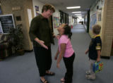 Outside her office, Principal Lynn Heintzman chats with third grade students Kayle Ducker and...