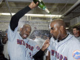 LAD119 - New York Mets' Michael Tucker, left, douses teammate Carlos Delgado with champagne after...